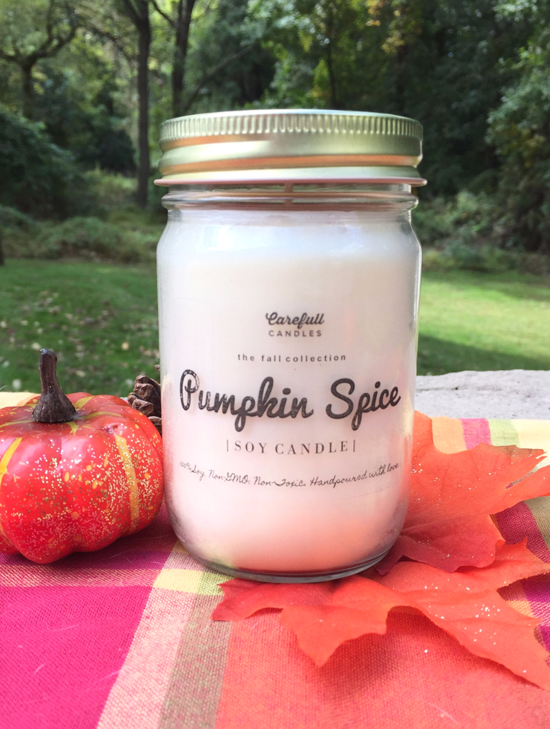 """A candle that smells exactly like a pumpkin spice latte!! This is the Carefull Candles Pumpkin Spice Scented Candle made from 100% non-GMO soy wax with no additives. The candle is scented using 100% natural essential oils and fragrance. Enter to win this candle at smelltheroses.com or buy it in their Etsy shop where code """"SMELLTHEROSES"""" saves you 20% !"""
