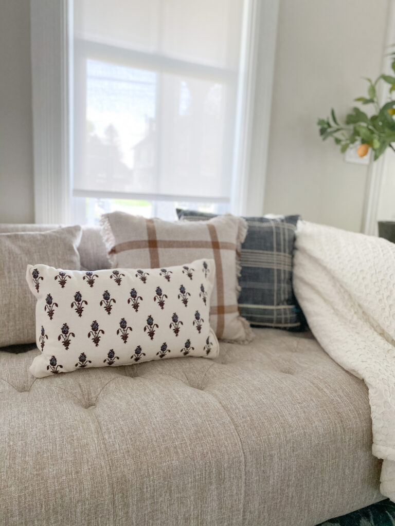 Couch styled with fall pillows from Target